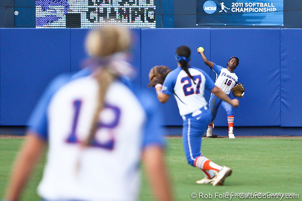 Florida junior center fielder Michelle Moultrie throws to her cutoff, freshman shortstop Cheyenne Coyle, during the Gator's 9-1 victory against the Oregon Ducks in the first day of the NCAA Super Regionals  on Friday, May 27, 2011 at Katie Seashole Pressly Stadium in Gainesville, Fla. / photo by Rob Foldy