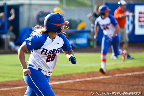 Florida senior catcher Tiffany DeFelice drives in sophomore Brittany Schutte for the Gator's 9-1 walk-off victory against the Oregon Ducks in the first day of the NCAA Super Regionals  on Friday, May 27, 2011 at Katie Seashole Pressly Stadium in Gainesville, Fla. / photo by Rob Foldy