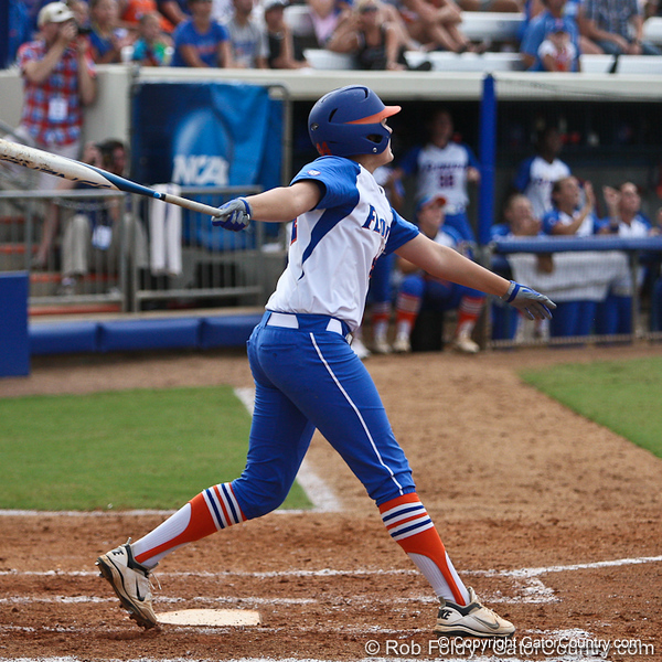 Florida sophomore Brittany Schutte watches her second home run soar over the left field fence during the Gator's 9-1 victory against the Oregon Ducks in the first day of the NCAA Super Regionals  on Friday, May 27, 2011 at Katie Seashole Pressly Stadium in Gainesville, Fla. / photo by Rob Foldy