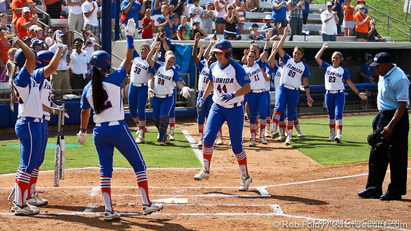 Florida sophomore Brittany Schutte is met by her teammates after she scores off her first home run during the Gator's 9-1 victory against the Oregon Ducks in the first day of the NCAA Super Regionals  on Friday, May 27, 2011 at Katie Seashole Pressly Stadium in Gainesville, Fla. / photo by Rob Foldy