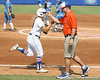 Florida senior catcher Tiffany DeFelice gets congratulated by head coach Tim Walton after hitting a home run during the Gators' 11-3 win against the UCLA Bruins in the NCAA Regional final on Sunday, May 22, 2011 at Katie Seashole Pressly Softball Stadium in Gainesville, Fla. / Gator Country photo by Tim Casey
