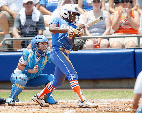 Florida junior center fielder Michelle Moultrie follows through on a swing during the Gators' 3-2 loss to the UCLA Bruins in the NCAA Regionals on Sunday, May 22, 2011 at Katie Seashole Pressly Softball Stadium in Gainesville, Fla. / Gator Country photo by Tim Casey