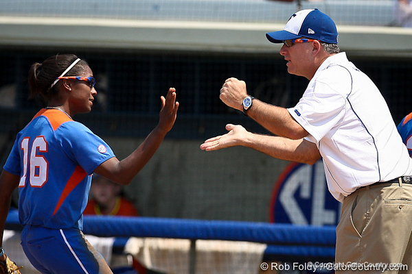 Florida head coach Tim Walton slaps hands with Michelle Moultrie during the Gator's 2-3 loss to the UCLA Bruins on Sunday, May 22, 2011 at Katie Seashole Pressly Stadium in Gainesville, Fla. / photo by Rob Foldy