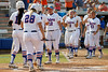 Florida freshman shortstop Cheyenne Coyle is greeted by Megan Bush after hitting a 2-run homer during the Gators' 11-3 win against the UCLA Bruins in the NCAA Regional final on Sunday, May 22, 2011 at Katie Seashole Pressly Softball Stadium in Gainesville, Fla. / Gator Country photo by Tim Casey