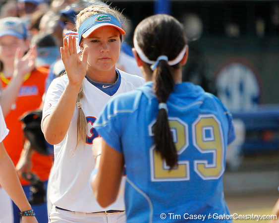 Florida senior first baseman Megan Bush slaps hands with UCLA players after the Gators' 11-3 win against the UCLA Bruins in the NCAA Regional final on Sunday, May 22, 2011 at Katie Seashole Pressly Softball Stadium in Gainesville, Fla. / Gator Country photo by Tim Casey