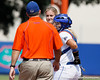Florida freshman pitcher Hannah Rogers talks with head coach Tim Walton during the Gators' 11-3 win against the UCLA Bruins in the NCAA Regional final on Sunday, May 22, 2011 at Katie Seashole Pressly Softball Stadium in Gainesville, Fla. / Gator Country photo by Tim Casey