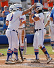Florida freshman shortstop Cheyenne Coyle is greeted at home after hitting a 2-run homer during the Gators' 11-3 win against the UCLA Bruins in the NCAA Regional final on Sunday, May 22, 2011 at Katie Seashole Pressly Softball Stadium in Gainesville, Fla. / Gator Country photo by Tim Casey
