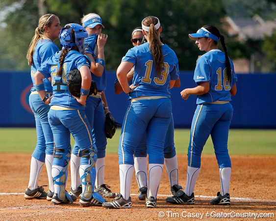 UCLA players huddle during the Gators' 11-3 win against the Bruins in the NCAA Regional final on Sunday, May 22, 2011 at Katie Seashole Pressly Softball Stadium in Gainesville, Fla. / Gator Country photo by Tim Casey