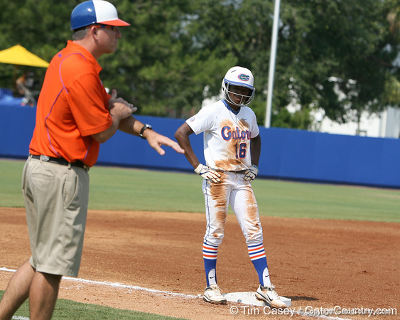 Florida junior center fielder Michelle Moultrie watches head coach Tim Walton make signals during the Gators' 11-3 win against the UCLA Bruins in the NCAA Regional final on Sunday, May 22, 2011 at Katie Seashole Pressly Softball Stadium in Gainesville, Fla. / Gator Country photo by Tim Casey