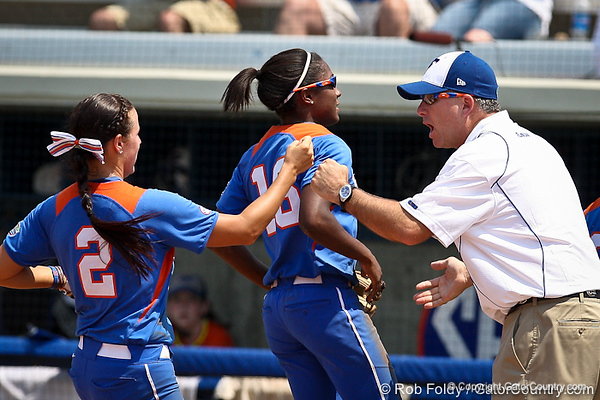 Florida head coach Tim Walton slaps hands with Kelsey Bruder during the Gator's 2-3 loss to the UCLA Bruins on Sunday, May 22, 2011 at Katie Seashole Pressly Stadium in Gainesville, Fla. / photo by Rob Foldy