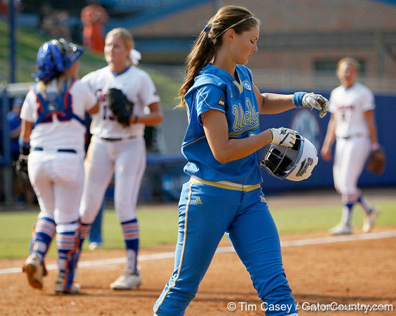 An UCLA player walks off of the fielder after the Gators' 11-3 win against the UCLA Bruins in the NCAA Regional final on Sunday, May 22, 2011 at Katie Seashole Pressly Softball Stadium in Gainesville, Fla. / Gator Country photo by Tim Casey