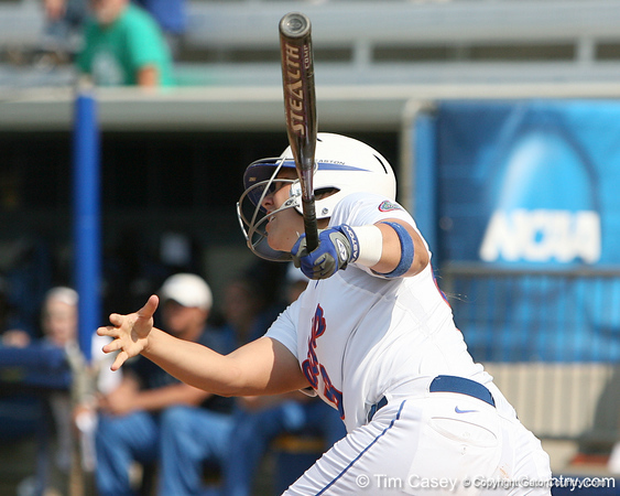 Florida senior catcher Tiffany DeFelice follows through on a home run during the Gators' 11-3 win against the UCLA Bruins in the NCAA Regional final on Sunday, May 22, 2011 at Katie Seashole Pressly Softball Stadium in Gainesville, Fla. / Gator Country photo by Tim Casey