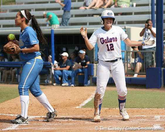 Florida senior first baseman Megan Bush reacts after scoring a run during the Gators' 11-3 win against the UCLA Bruins in the NCAA Regional final on Sunday, May 22, 2011 at Katie Seashole Pressly Softball Stadium in Gainesville, Fla. / Gator Country photo by Tim Casey