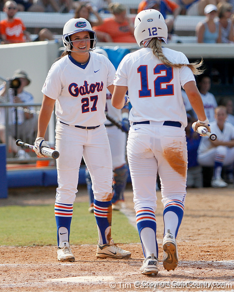 Florida freshman shortstop Cheyenne Coyle talks with senior first baseman Megan Bush during the Gators' 11-3 win against the UCLA Bruins in the NCAA Regional final on Sunday, May 22, 2011 at Katie Seashole Pressly Softball Stadium in Gainesville, Fla. / Gator Country photo by Tim Casey