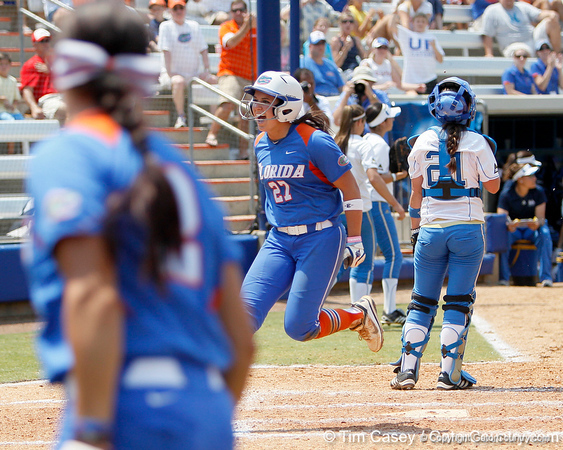 Florida freshman shortstop Cheyenne Coyle reacts after scoring on a throwing error after a sacrifice fly during the Gators' 3-2 loss to the UCLA Bruins in the NCAA Regionals on Sunday, May 22, 2011 at Katie Seashole Pressly Softball Stadium in Gainesville, Fla. / Gator Country photo by Tim Casey