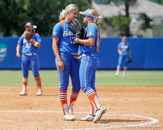 Florida freshman pitcher Hannah Rogers talks with senior first baseman Megan Bush during the Gators' 3-2 loss to the UCLA Bruins in the NCAA Regionals on Sunday, May 22, 2011 at Katie Seashole Pressly Softball Stadium in Gainesville, Fla. / Gator Country photo by Tim Casey