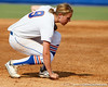 Florida freshman third baseman Kasey Fagan grabs a handful of dirt during the Gators' 11-3 win against the UCLA Bruins in the NCAA Regional final on Sunday, May 22, 2011 at Katie Seashole Pressly Softball Stadium in Gainesville, Fla. / Gator Country photo by Tim Casey