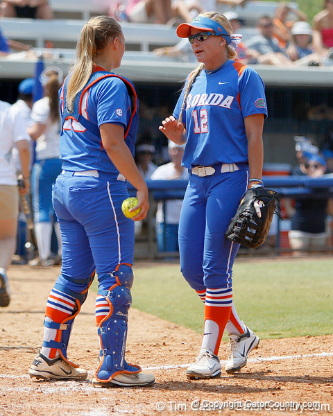 Florida senior catcher Tiffany DeFelice talks with senior first baseman Megan Bush during the Gators' 3-2 loss to the UCLA Bruins in the NCAA Regionals on Sunday, May 22, 2011 at Katie Seashole Pressly Softball Stadium in Gainesville, Fla. / Gator Country photo by Tim Casey