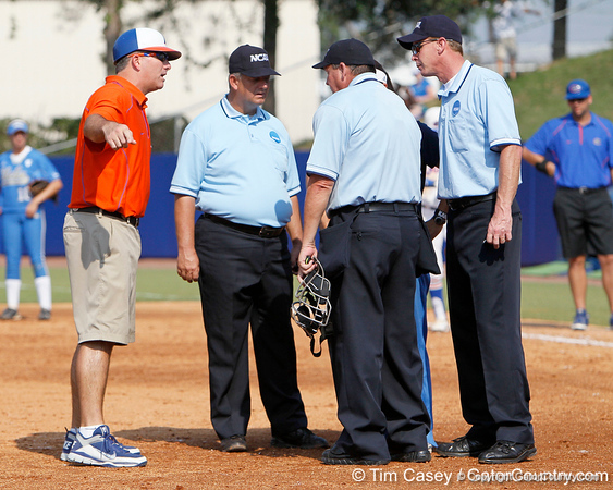 Florida head coach Tim Walton talks with umpires after both teams received a warning during the Gators' 11-3 win against the UCLA Bruins in the NCAA Regional final on Sunday, May 22, 2011 at Katie Seashole Pressly Softball Stadium in Gainesville, Fla. / Gator Country photo by Tim Casey