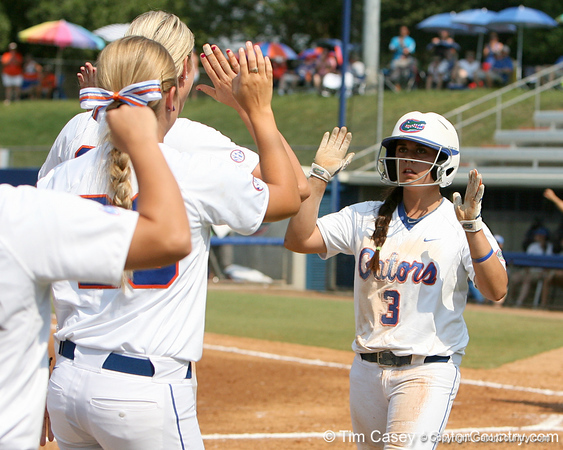 Florida senior second baseman Aja Paculba is greeted by teammates after scoring during the Gators' 11-3 win against the UCLA Bruins in the NCAA Regional final on Sunday, May 22, 2011 at Katie Seashole Pressly Softball Stadium in Gainesville, Fla. / Gator Country photo by Tim Casey