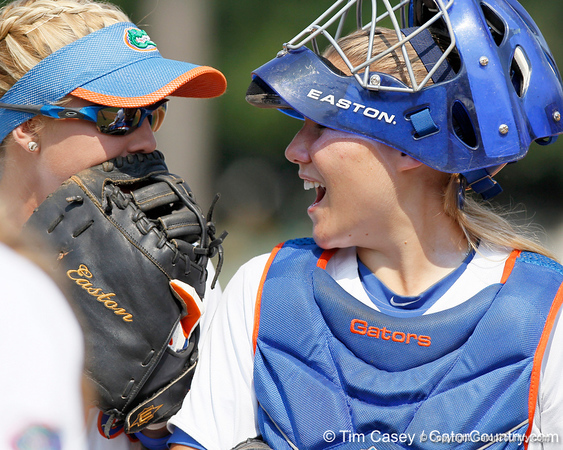 Florida senior first baseman Megan Bush talks with senior catcher Tiffany DeFelice during the Gators' 11-3 win against the UCLA Bruins in the NCAA Regional final on Sunday, May 22, 2011 at Katie Seashole Pressly Softball Stadium in Gainesville, Fla. / Gator Country photo by Tim Casey