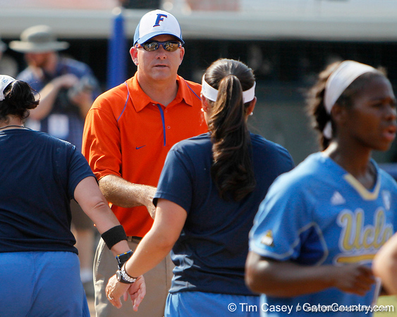 Florida head coach Tim Walton shakes hands with UCLA head coach Kelly Inouye-Perez after the Gators' 11-3 win against the UCLA Bruins in the NCAA Regional final on Sunday, May 22, 2011 at Katie Seashole Pressly Softball Stadium in Gainesville, Fla. / Gator Country photo by Tim Casey