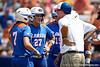 Florida head coach Tim Walton talks with Lauren Heil, Cheyenne Coyle, Samantha Holle, and Aja Paculba during the Gator's 2-3 loss to the UCLA Bruins on Sunday, May 22, 2011 at Katie Seashole Pressly Stadium in Gainesville, Fla. / photo by Rob Foldy