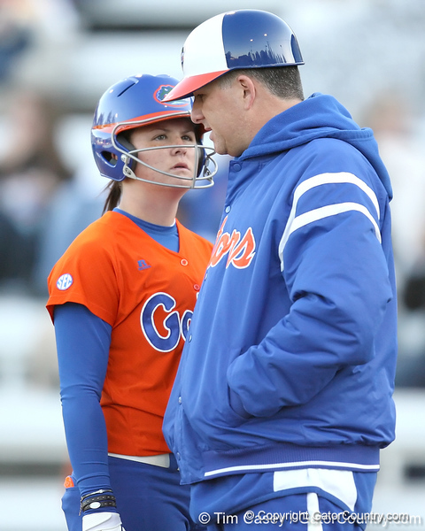 Florida freshman Brittany Walker listens to head coach Tim Walton during the Gators' 6-1 win against the Jacksonville Dolphins on Wednesday, February 17, 2010 at Katie Seashole Pressly Softball Stadium in Gainesville, Fla. / Gator Country photo by Tim Casey