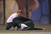 Jacksonville left fielder Katarina Engler is checked by trainers after a collision with the shortstop during the Gators' 6-1 win against the Jacksonville Dolphins on Wednesday, February 17, 2010 at Katie Seashole Pressly Softball Stadium in Gainesville, Fla. / Gator Country photo by Tim Casey