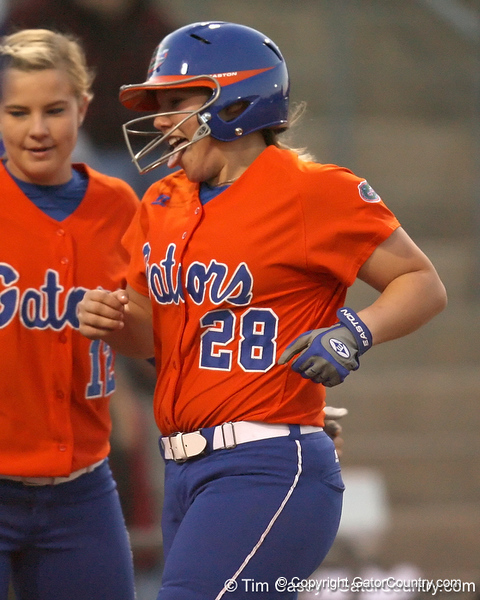 Florida junior catcher Tiffany DeFelice crosses the plate after hitting a home run  during the Gators' 6-1 win against the Jacksonville Dolphins on Wednesday, February 17, 2010 at Katie Seashole Pressly Softball Stadium in Gainesville, Fla. / Gator Country photo by Tim Casey