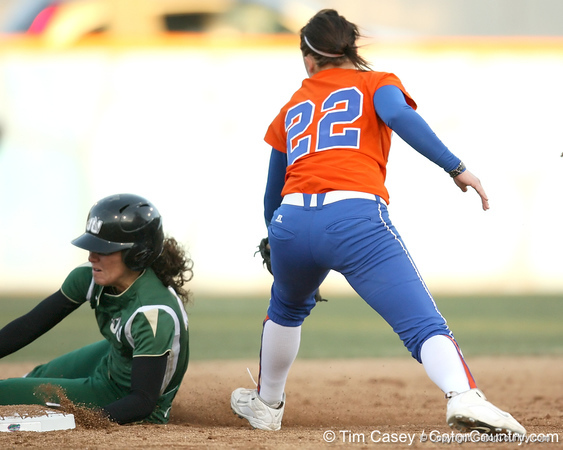 Florida freshman Brittany Walker attempts to tag a runner during the Gators' 6-1 win against the Jacksonville Dolphins on Wednesday, February 17, 2010 at Katie Seashole Pressly Softball Stadium in Gainesville, Fla. / Gator Country photo by Tim Casey