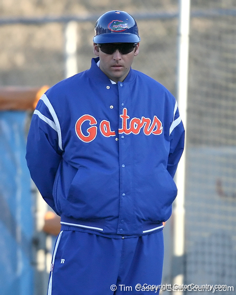 Florida volunteer coach Coy Adkins stands in the first-base coach's box during the Gators' 6-1 win against the Jacksonville Dolphins on Wednesday, February 17, 2010 at Katie Seashole Pressly Softball Stadium in Gainesville, Fla. / Gator Country photo by Tim Casey