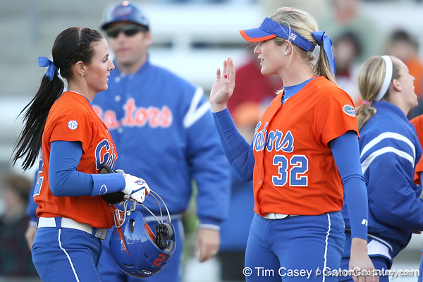 Florida junior Kelsey Bruder celebrates with Stephanie Brombacher during the Gators' 6-1 win against the Jacksonville Dolphins on Wednesday, February 17, 2010 at Katie Seashole Pressly Softball Stadium in Gainesville, Fla. / Gator Country photo by Tim Casey