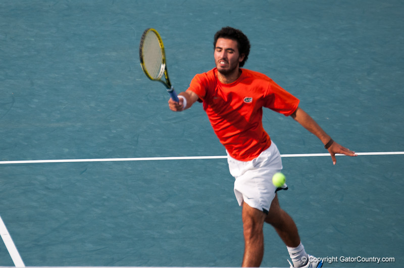Florida senior Nassim Slilam hits a forehand during the Gators' 7-0 win against the Auburn Tigers on Friday, March 30, 2012 at the Alfred A Ring Tennis Complex in Gainesville, Fla. / Gator Country photo by Saj Guevara