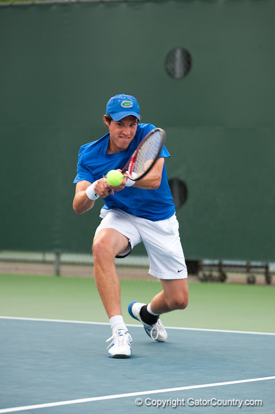 Florida sophomore Michael Alford hits a backhand during the Gators' 7-0 win against the Auburn Tigers on Friday, March 30, 2012 at the Alfred A Ring Tennis Complex in Gainesville, Fla. / Gator Country photo by Saj Guevara