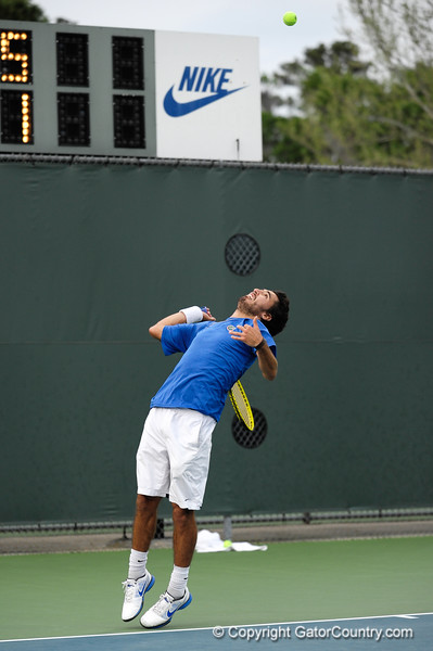 Florida senior Nassim Slilam serves during the Gators' 7-0 win against the Auburn Tigers on Friday, March 30, 2012 at the Alfred A Ring Tennis Complex in Gainesville, Fla. / Gator Country photo by Saj Guevara