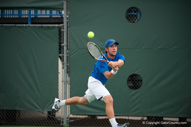 Florida junior Tripper Carleton hits a backhand during the Gators' 7-0 win against the Auburn Tigers on Friday, March 30, 2012 at the Alfred A Ring Tennis Complex in Gainesville, Fla. / Gator Country photo by Saj Guevara
