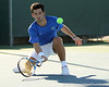 Florida senior Alexandre Lacroix reaches to return a drop shot during the No. 9-ranked Gators' 5-2 win against the No. 7-ranked Baylor Bears on Sunday, January 23, 2011 at Linder Stadium at Ring Tennis Complex in Gainesville, Fla. / Gator Country photo by Tim Casey