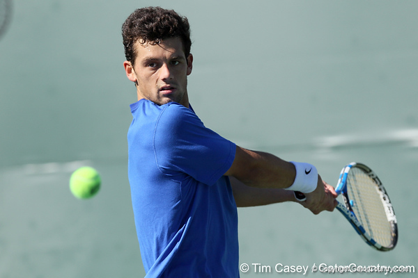 Florida senior Alexandre Lacroix winds up to return a serve during the No. 9-ranked Gators' 5-2 win against the No. 7-ranked Baylor Bears on Sunday, January 23, 2011 at Linder Stadium at Ring Tennis Complex in Gainesville, Fla. / Gator Country photo by Tim Casey
