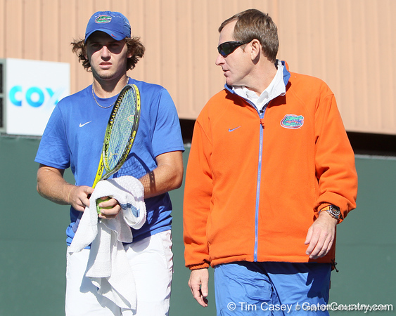 Florida freshman Andrew Butz listens to head coach Andy Jackson during the No. 9-ranked Gators' 5-2 win against the No. 7-ranked Baylor Bears on Sunday, January 23, 2011 at Linder Stadium at Ring Tennis Complex in Gainesville, Fla. / Gator Country photo by Tim Casey
