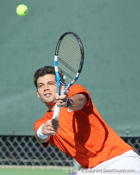 Florida senior Alexandre Lacroix returns a volley during the No. 9-ranked Gators' 5-2 win against the No. 7-ranked Baylor Bears on Sunday, January 23, 2011 at Linder Stadium at Ring Tennis Complex in Gainesville, Fla. / Gator Country photo by Tim Casey
