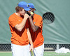 Florida sophomore Sekou Bangoura, Jr. talks with doubles teammate sophomore Sekou Bangoura, Jr. during the No. 9-ranked Gators' 5-2 win against the No. 7-ranked Baylor Bears on Sunday, January 23, 2011 at Linder Stadium at Ring Tennis Complex in Gainesville, Fla. / Gator Country photo by Tim Casey