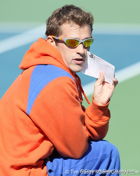 Florida student assistant men's tennis coach Antoine Benneteau gives instructions during the No. 9-ranked Gators' 5-2 win against the No. 7-ranked Baylor Bears on Sunday, January 23, 2011 at Linder Stadium at Ring Tennis Complex in Gainesville, Fla. / Gator Country photo by Tim Casey