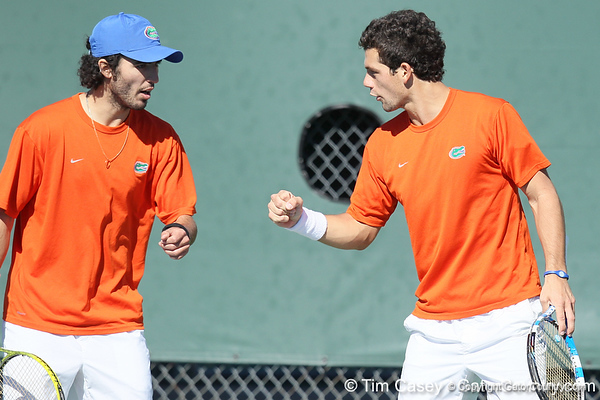 Florida junior Nassim Slilam and senior Alexandre Lacroix celebrate after winning a doubles point during the No. 9-ranked Gators' 5-2 win against the No. 7-ranked Baylor Bears on Sunday, January 23, 2011 at Linder Stadium at Ring Tennis Complex in Gainesville, Fla. / Gator Country photo by Tim Casey