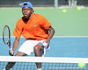 Florida sophomore Sekou Bangoura, Jr. follows the ball during the No. 9-ranked Gators' 5-2 win against the No. 7-ranked Baylor Bears on Sunday, January 23, 2011 at Linder Stadium at Ring Tennis Complex in Gainesville, Fla. / Gator Country photo by Tim Casey