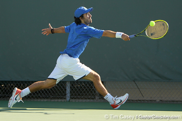 Florida junior Nassim Slilam reaches for a shot during the No. 9-ranked Gators' 5-2 win against the No. 7-ranked Baylor Bears on Sunday, January 23, 2011 at Linder Stadium at Ring Tennis Complex in Gainesville, Fla. / Gator Country photo by Tim Casey