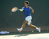Florida senior Alexandre Lacroix runs to return a shot during the No. 9-ranked Gators' 5-2 win against the No. 7-ranked Baylor Bears on Sunday, January 23, 2011 at Linder Stadium at Ring Tennis Complex in Gainesville, Fla. / Gator Country photo by Tim Casey