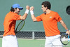 Florida junior Nassim Slilam and senior Alexandre Lacroix celebrate a doubles point during the No. 9-ranked Gators' 5-2 win against the No. 7-ranked Baylor Bears on Sunday, January 23, 2011 at Linder Stadium at Ring Tennis Complex in Gainesville, Fla. / Gator Country photo by Tim Casey