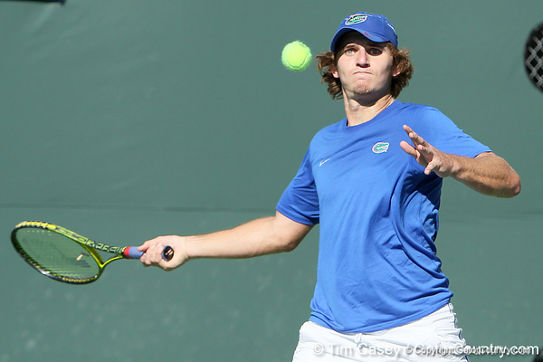 Florida freshman Andrew Butz eyes the ball during the No. 9-ranked Gators' 5-2 win against the No. 7-ranked Baylor Bears on Sunday, January 23, 2011 at Linder Stadium at Ring Tennis Complex in Gainesville, Fla. / Gator Country photo by Tim Casey