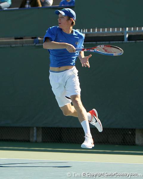 Florida sophomore Bob van Overbeek follows through on a swing during the No. 9-ranked Gators' 5-2 win against the No. 7-ranked Baylor Bears on Sunday, January 23, 2011 at Linder Stadium at Ring Tennis Complex in Gainesville, Fla. / Gator Country photo by Tim Casey
